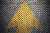Yellow Arrow paint on steel — Stock Photo