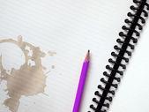 Purple pencil on white note book — Stock Photo