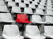 Red seat in White seats — Stock Photo
