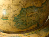 Old map on a globe — Stock Photo