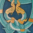 Twin Snakes Thai Art Painting on Wall - Stock Photo
