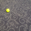 Small ball on carpet - Stock Photo