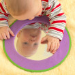 Royalty-Free Stock Photo: Baby boy plays with toy mirror