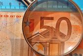 Magnifying glass euro — Stock Photo