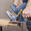 Carpenter with circular saw — Stock Photo #5630355