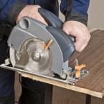 Carpenter with circular saw — Stock Photo #5630367
