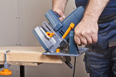 Carpenter with circular saw — Foto Stock