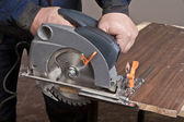 Carpenter with circular saw — Zdjęcie stockowe
