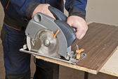 Carpenter with circular saw — Stock Photo