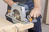 Carpenter with circular saw — Stock Photo