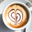Stock Photo: Cup of coffee with heart-shaped decoration