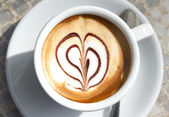 A cup of coffee with heart-shaped decoration — Stock Photo