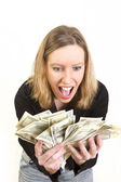 Young woman have lots of dollars in her hands and looking happy — Stock Photo