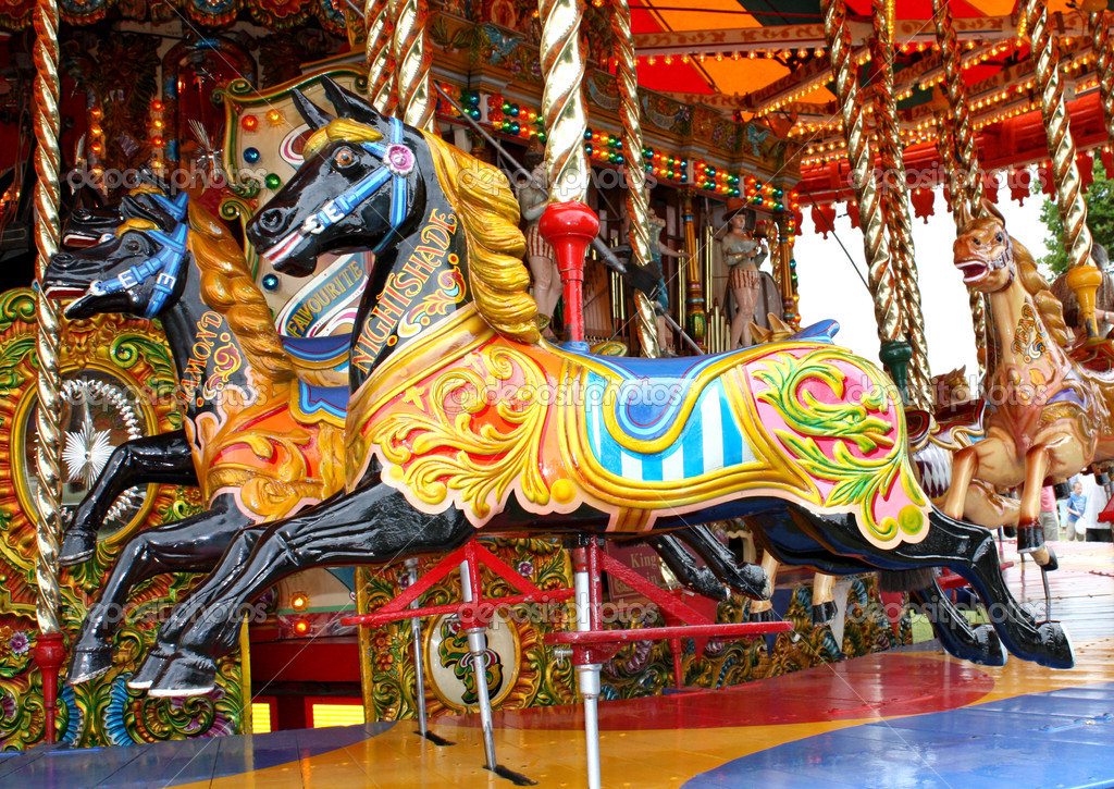 Carousel Horses on a Traditional Fun Fair Ride. — Stock Photo #5856228