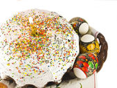 Easter cake with candle and eggs on a white background — Stock Photo