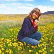 Royalty-Free Stock Photo: Beautiful girl on a dandelions field