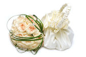 Wedding bouquet and bag — Stock Photo