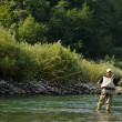 Foto Stock: Fishing on mountain river