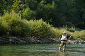 Fishing on the mountain river — Foto Stock