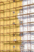 Scaffolding on a building wall — Stock Photo