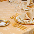 Golden cutlery with crystal glass — Stock Photo #6085582