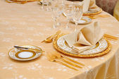 Golden cutlery with crystal glass — Stock Photo