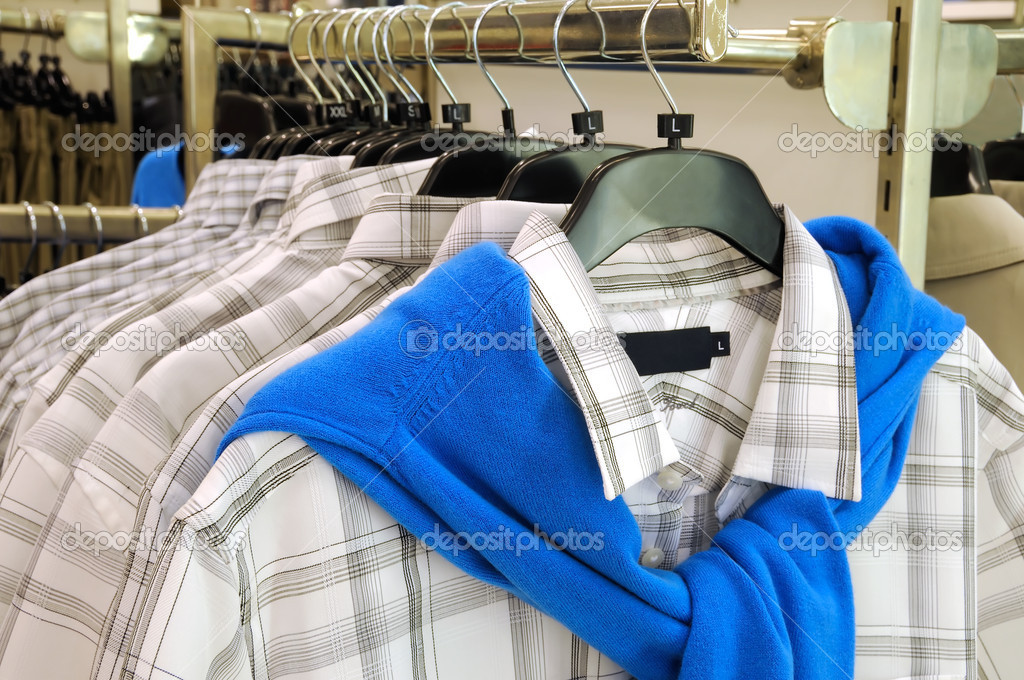 Clothes hanger with shirts in the boutique  — Stock Photo #6189773