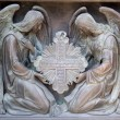 Bas-reliefs of angels with cross — Stock Photo