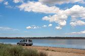 Car on the beach — Stock Photo