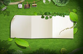 Blank paper on green grass. background concept — Stock Photo