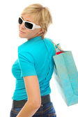Charming blonde with a shopping bag — Stock Photo
