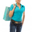 Charming blonde with a shopping bag — Stock Photo #5444985