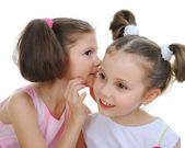 Two beautiful girls telling secret — Stock Photo