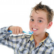 Beautiful little boy cleans your teeth — Stock Photo #5914430