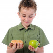 Little boy eating a hamburger — Stock Photo