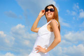 Beautiful Woman over blue Sky — Stockfoto