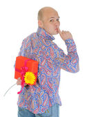 Man with a gift box and a flower — Stock Photo