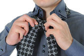 Businessman tying his tie — Stock Photo