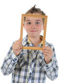 Little boy with a frame in his hands — Stock Photo