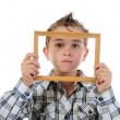 Little boy with a frame in his hands — Stock Photo #6037059