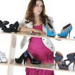 Woman choosing shoes at a store — Stock Photo