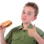 Little boy eating a hamburger — Stock Photo