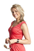 Attractive young woman in a red dress — Stock Photo