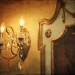 Wall light sconce with mirror and vintage background — Stock Photo