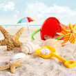 Children's beach toys at the beach - Stock Photo
