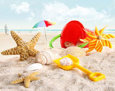 Children's beach toys at the beach — Stock Photo