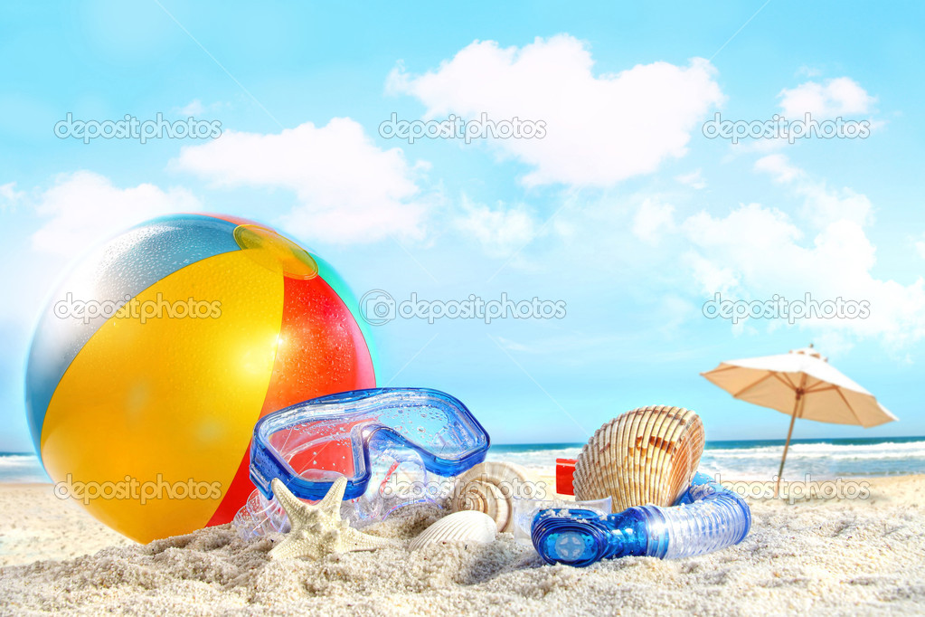 Fun day at the beach with goggles and beach ball — Stock Photo #5660191
