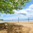 Picnic tables at the beach - Stockfoto
