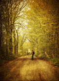 Man walking on a lonely country road — Stock Photo