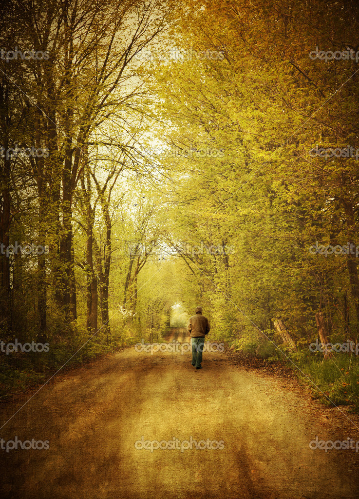 Man walking alone on a lonely country road — Stock Photo #6082761
